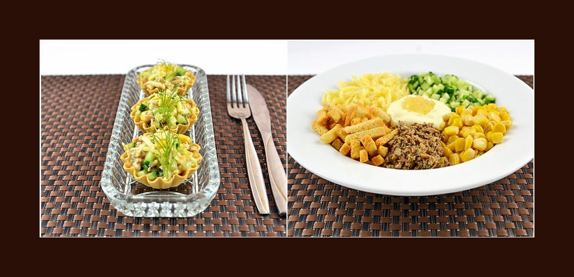Herzhafter Salat mit Gurken, Sprotten, Crotouns, Käse, Mais und Knoblauch