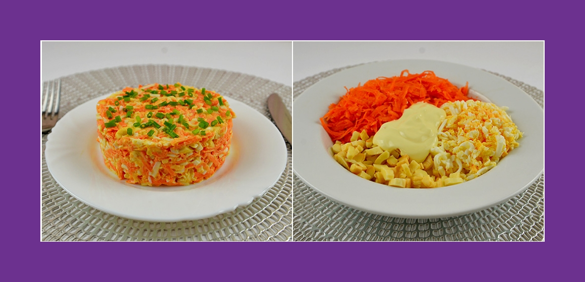 Lecker Salat mit Karotten, geräuchertem Käse, Eiern und Knoblauch